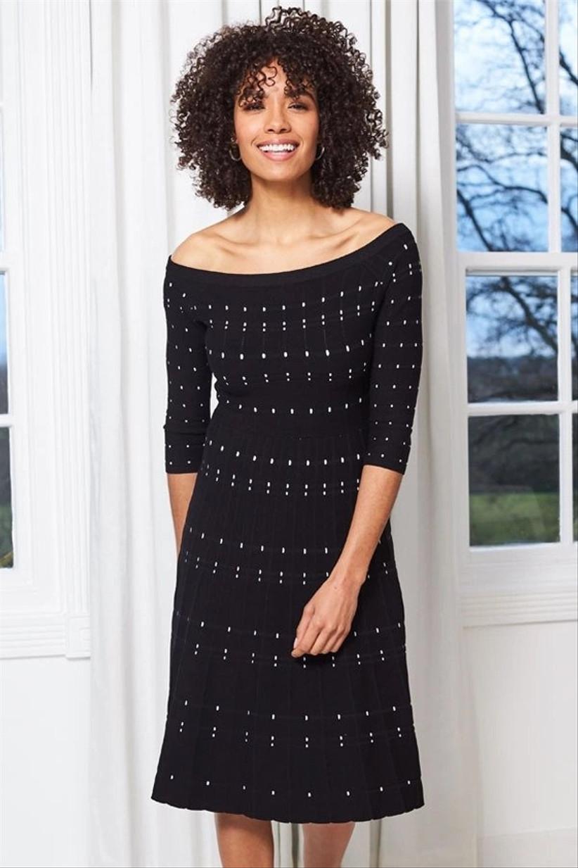 Black dress with white stripes and a Bardot neckline