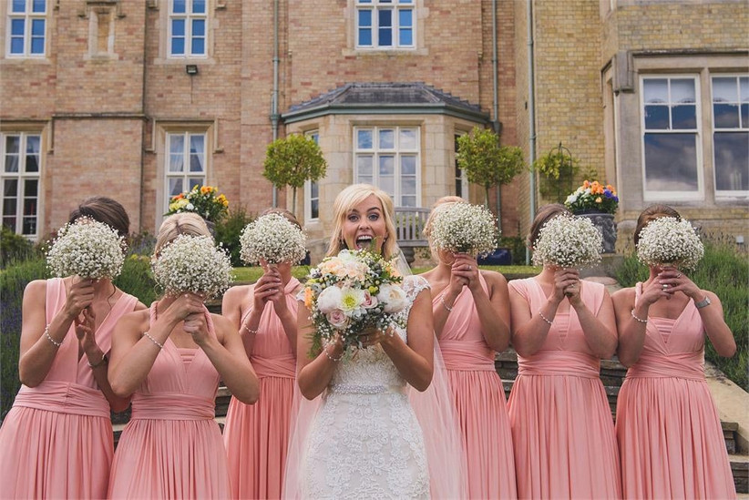 bridesmaids-with-pink-dresses-and-gypsophila-bouquets