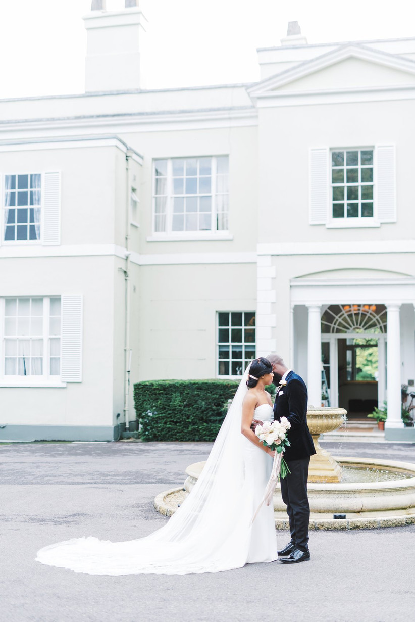 Bride and groom outside a country house