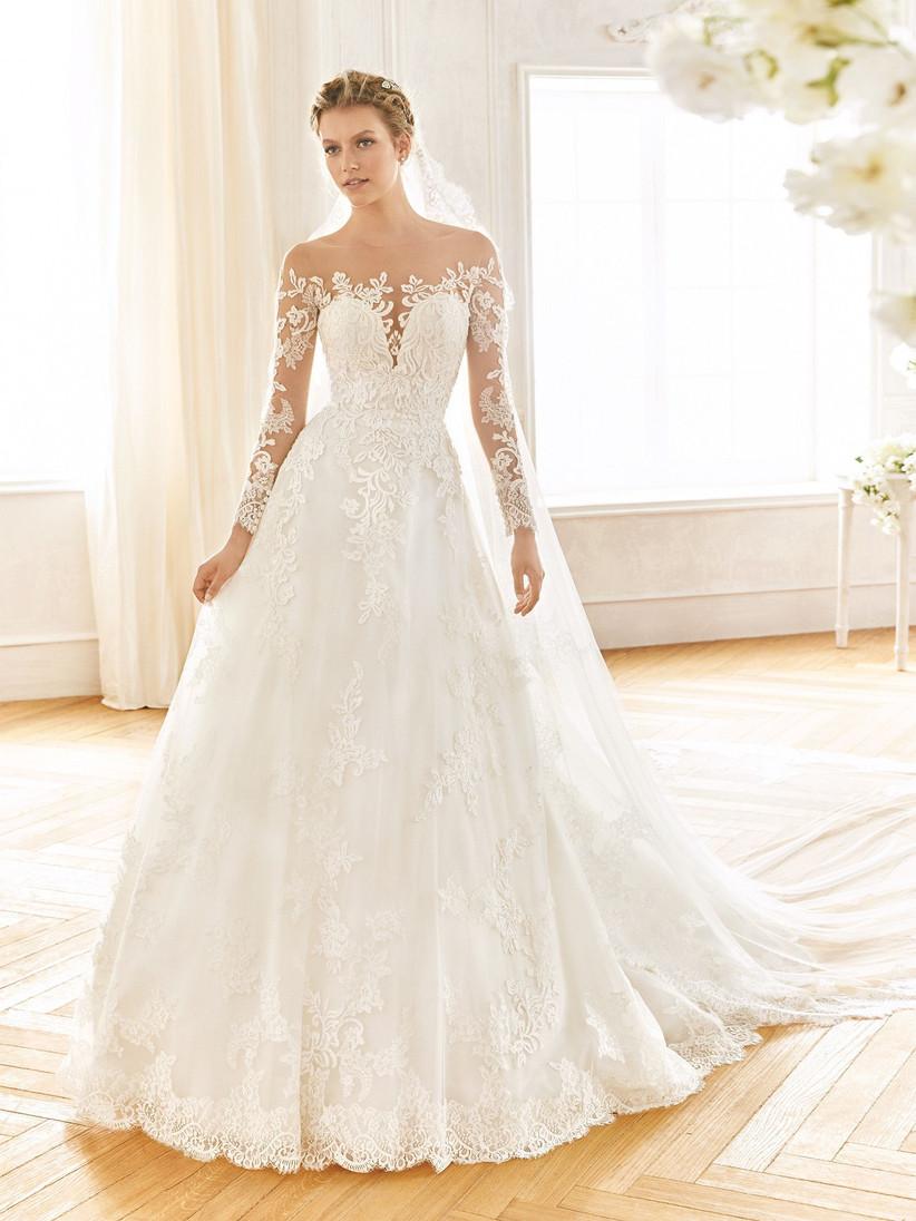 Model wearing a long sleeved lace sheer wedding dress