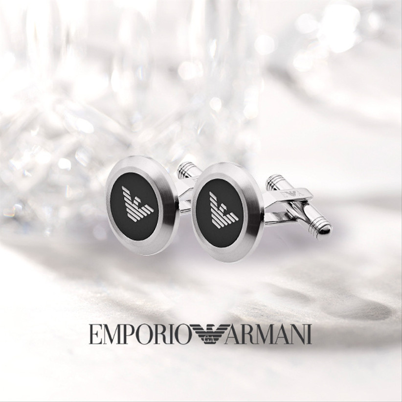 Silver cufflinks with silver Armani logo on a black background