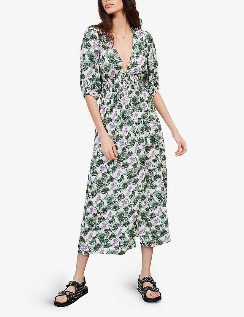 Girl wearing a tropical print midi dress
