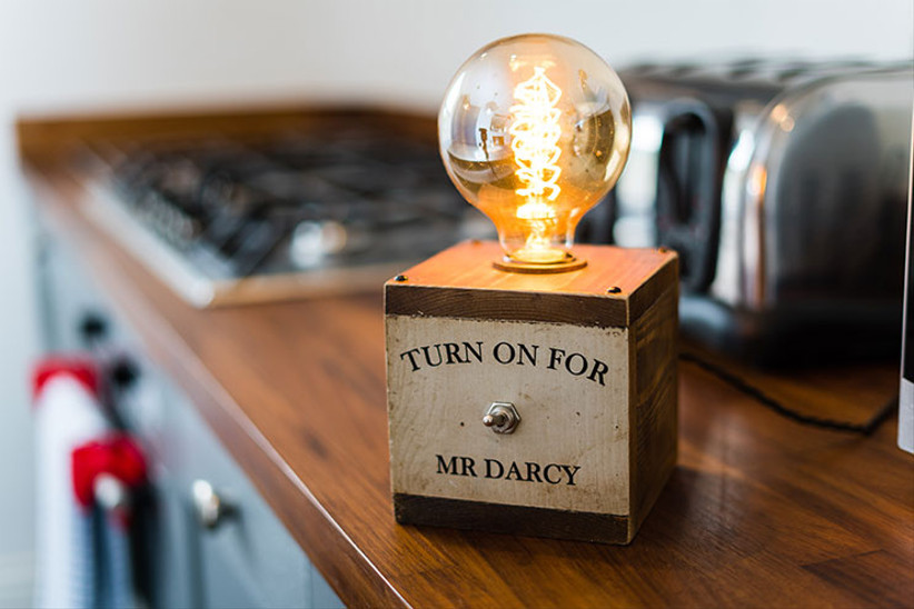 Light bulb with sign saying Turn On For Mr Darcy
