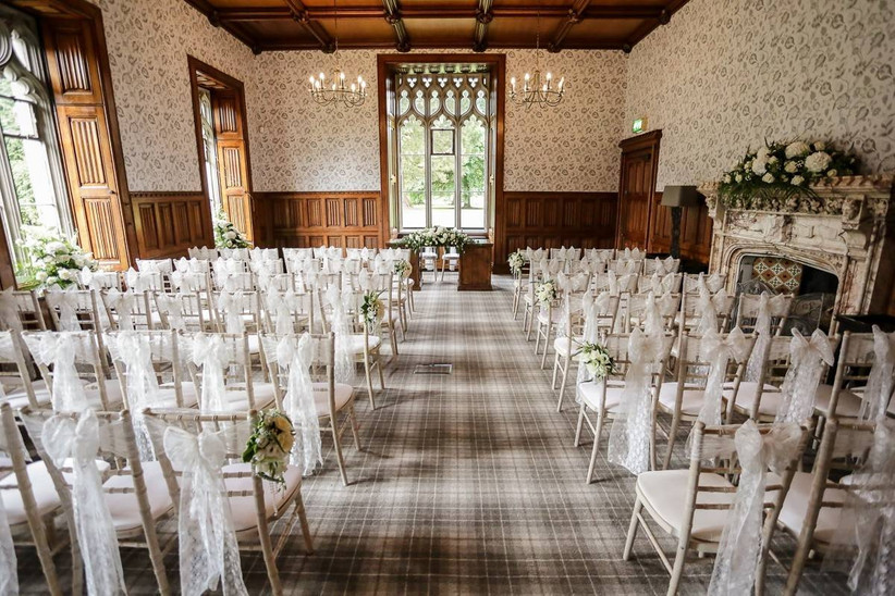 Wedding ceremony room with wallpaper and a fireplace