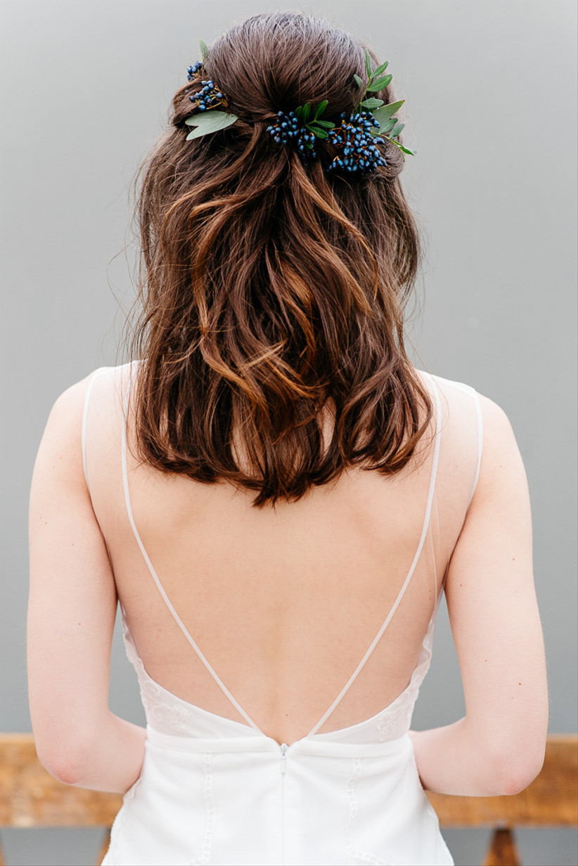 Half up half down hairstyle with winter berries