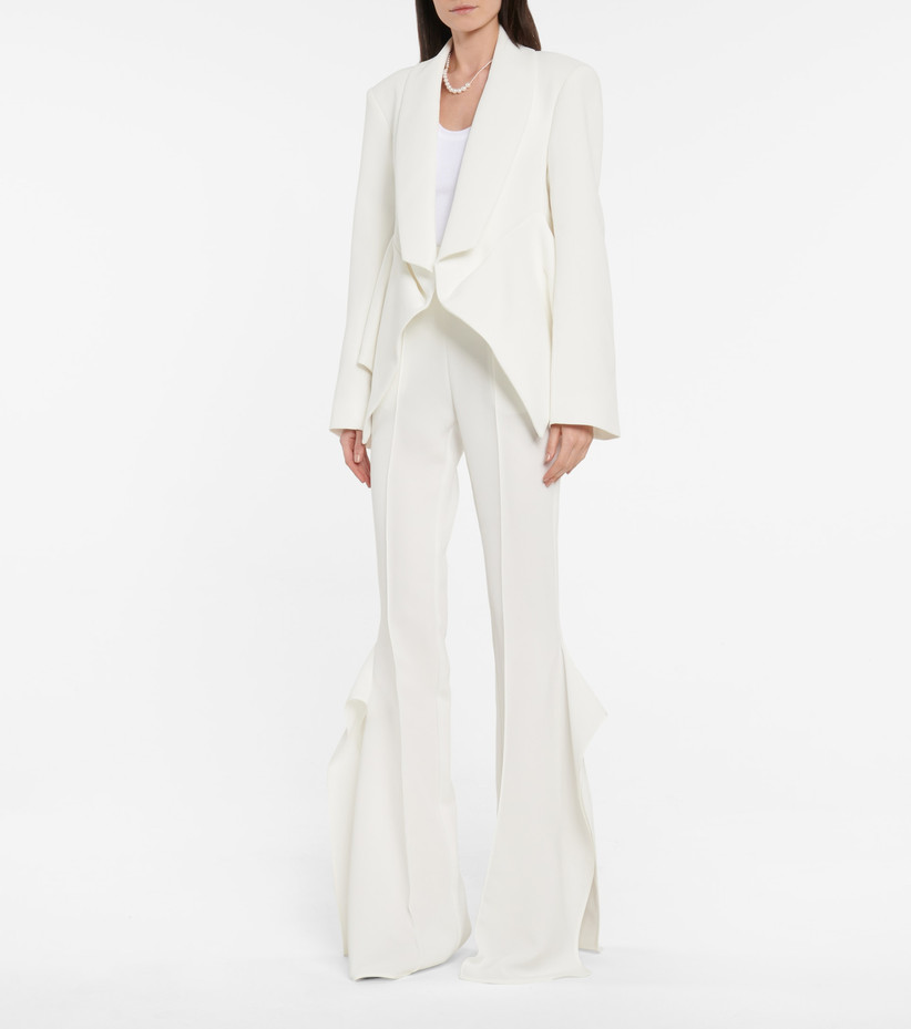 Girl wearing a white suit with flared trousers