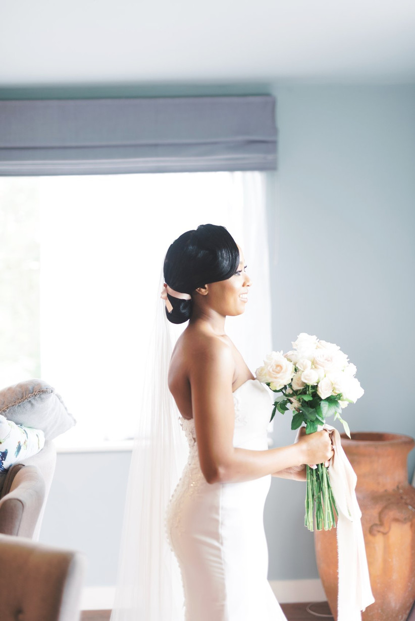 Bride in profile holding a bouquet