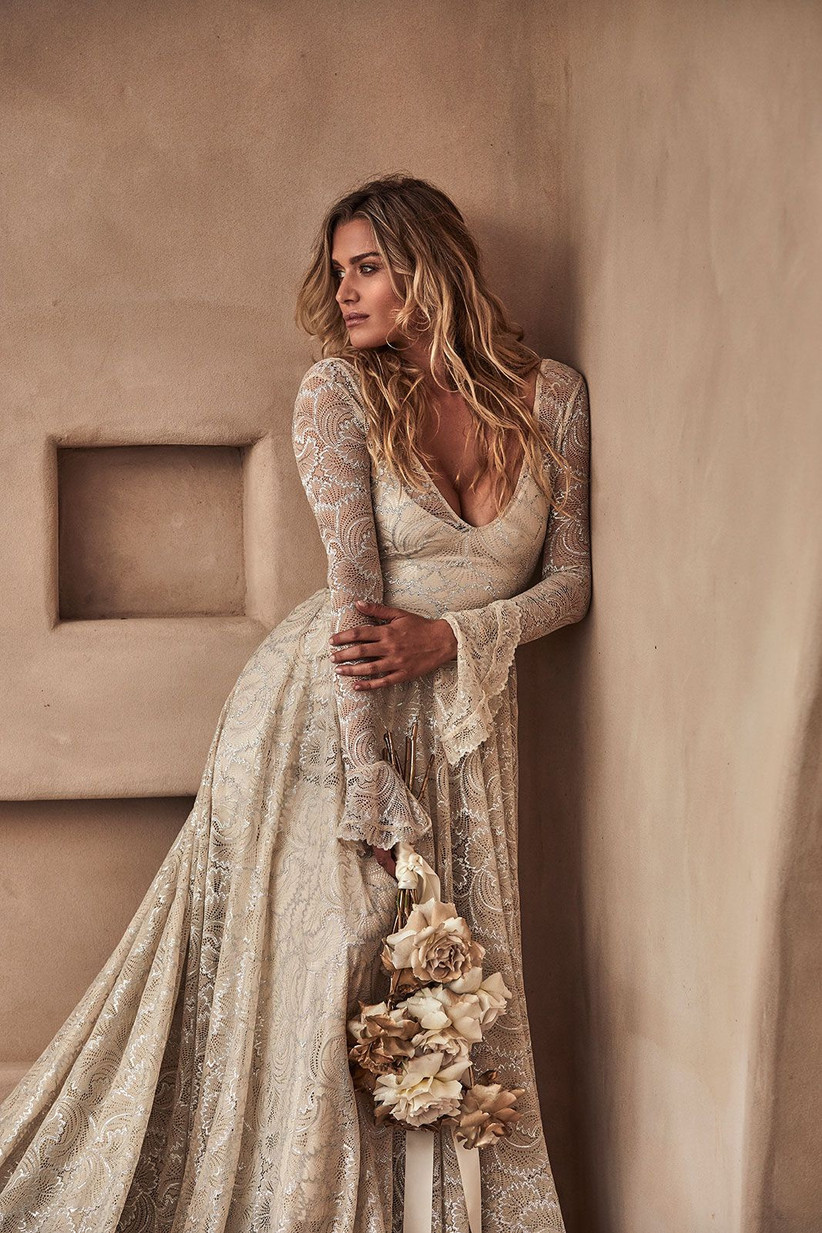 Model wearing a long sleeved sequin and lace wedding dress