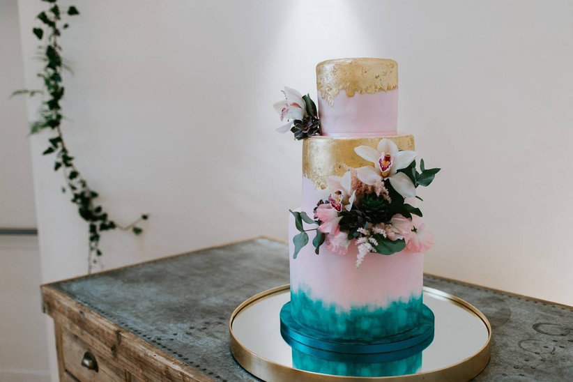 Pink gold and blue tiered wedding cake