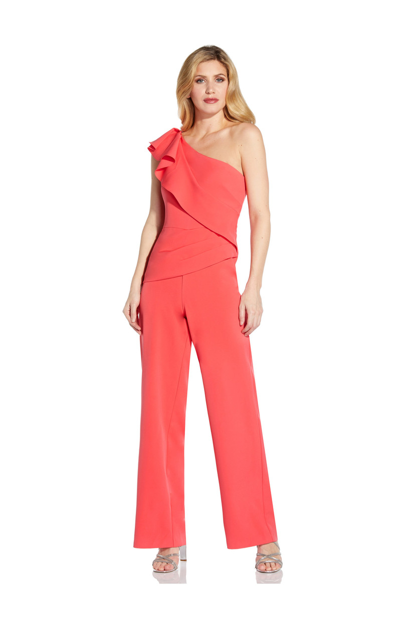 Girl wearing a coral jumpsuit with a ruffle shoulder