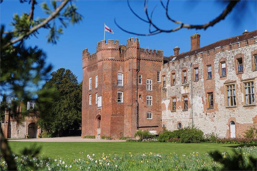 Castle in manicured grounds with a flag