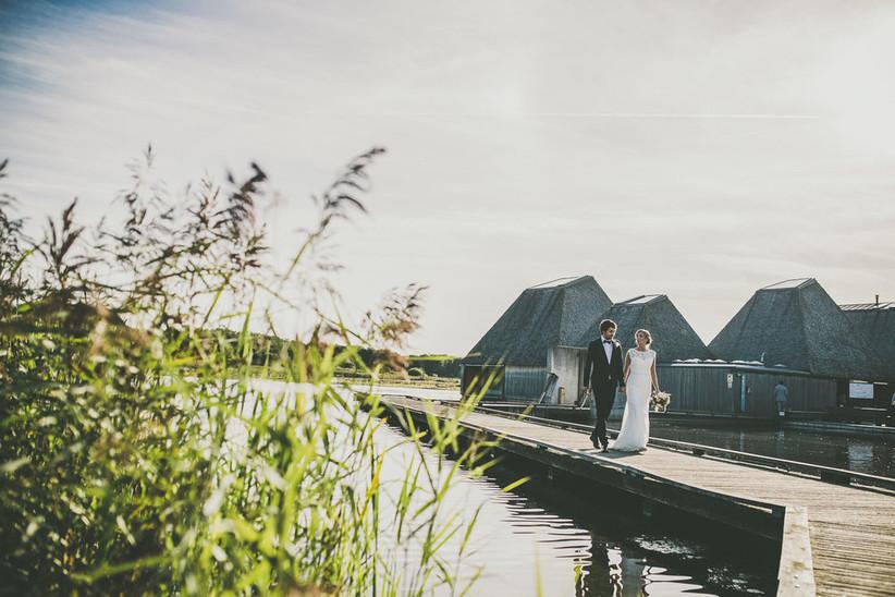 Bride and groom walking outside Lancashire wedding venue Brockholes Nature Reserve