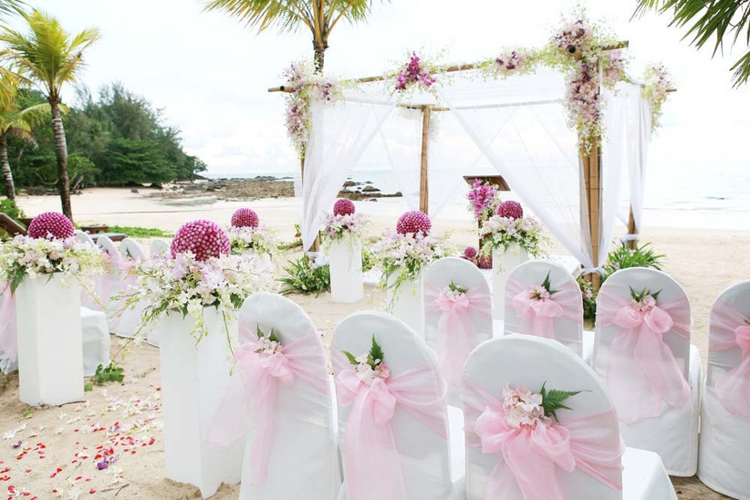 have-a-gorgeous-wedding-ceremony-on-the-beach-and-feature-lots-of-white-and-floral-details