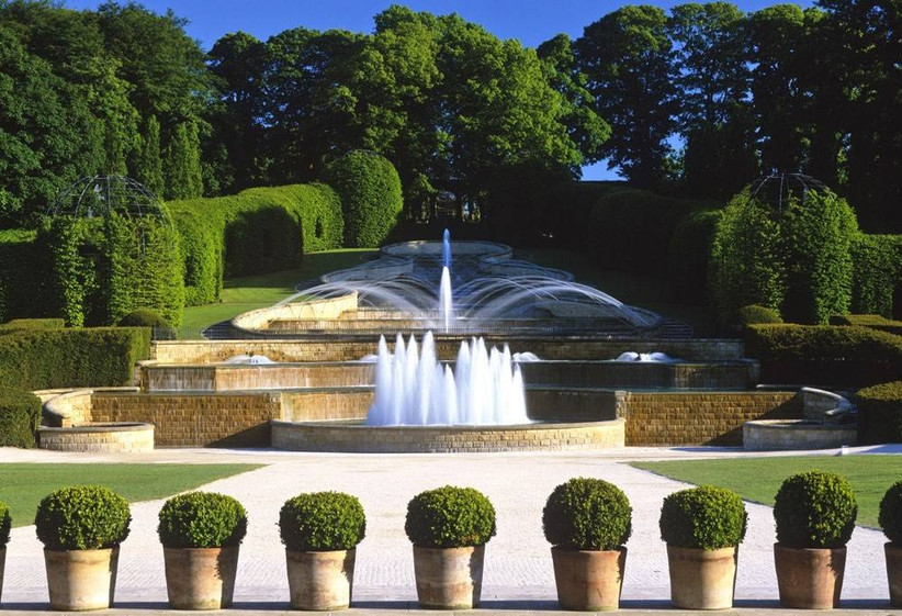 Manicured water feature with hedges