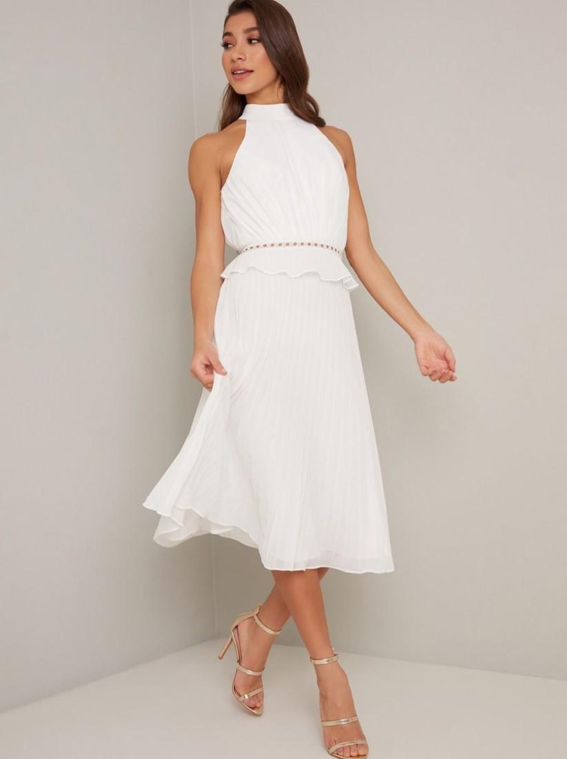 Model wearing a white halter neck bridesmaid dress