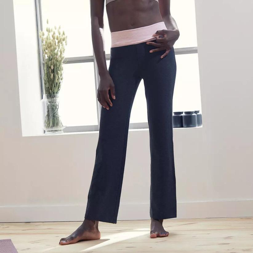 Model wearing cotton yoga bottoms