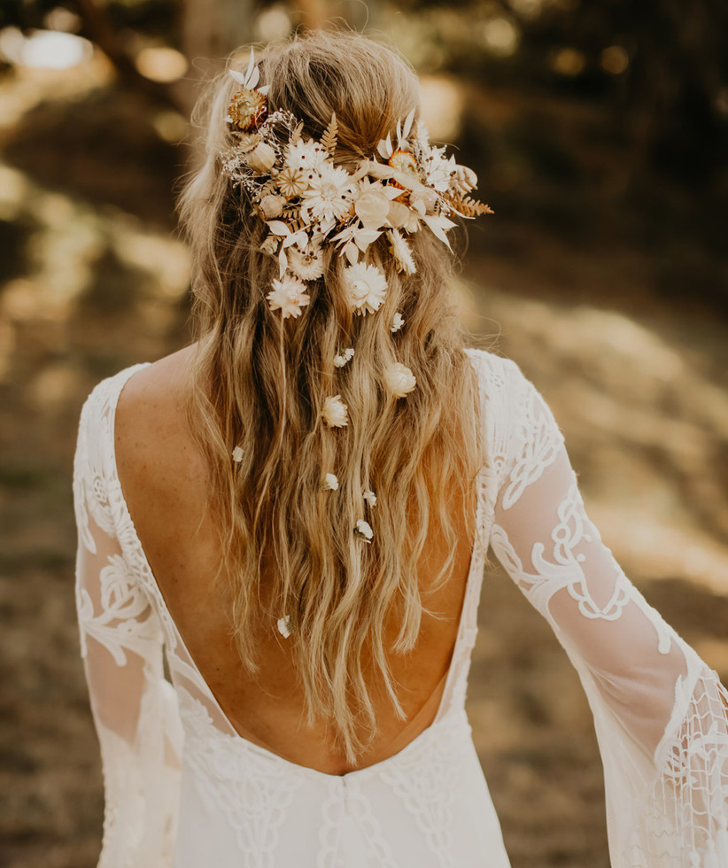 Dried flowers trailing through a half up half down hairstyle