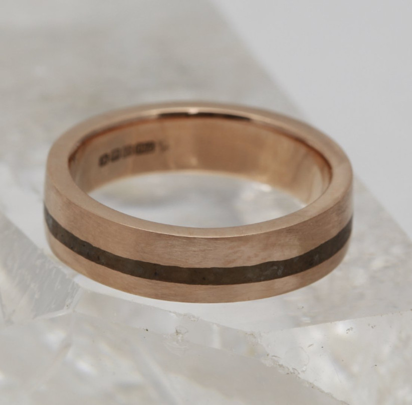 Matt thick gold ring with a dark brown panel running through the middle