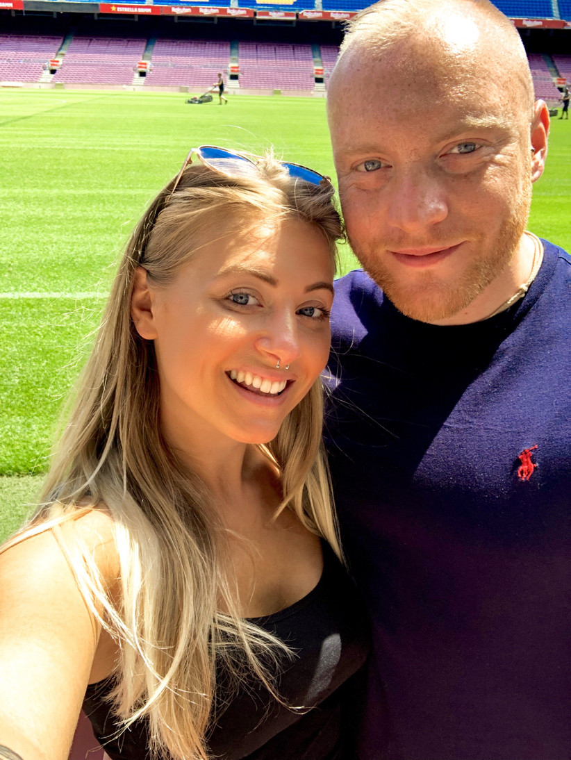 The writer and her fiance on a football pitch