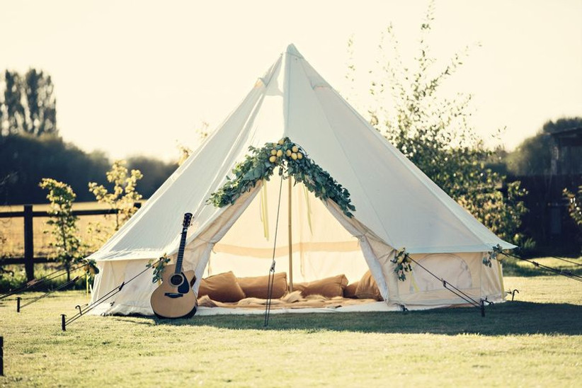 Outside tent with fruit decoration and guitar