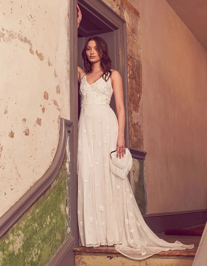 Girl wearing a beaded white wedding dress