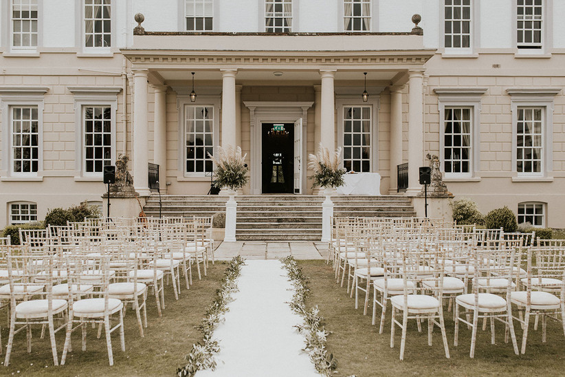 An outdoor wedding ceremony at Buxted Park