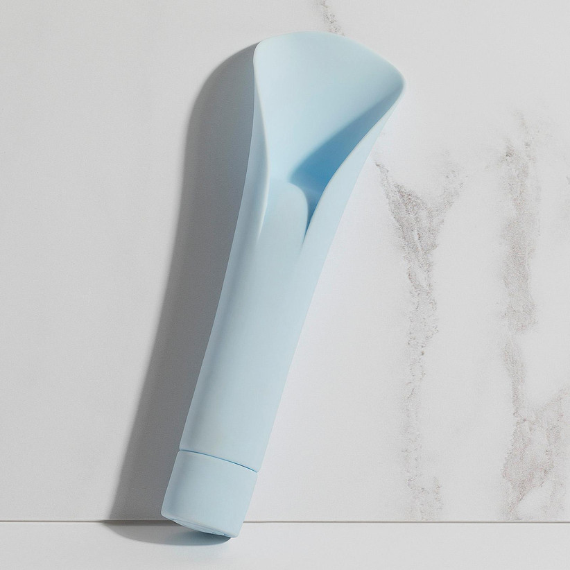 Light blue vibrator with a fan shaped head against a marble backdrop