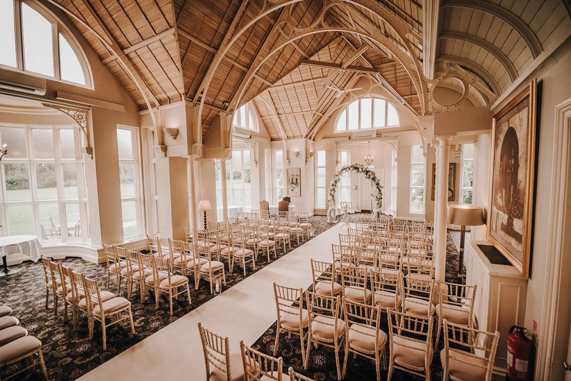 Large wedding ceremony room with wooden ceilings