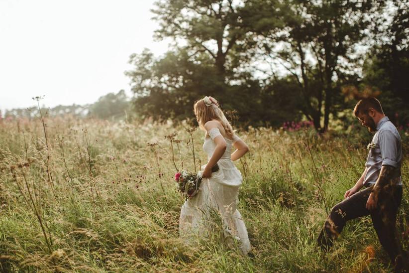 Bride and groom walking through a wildflower garden
