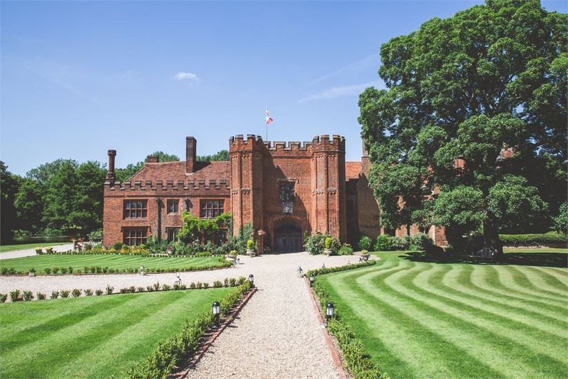 Outside view of a Tudor castle with manicured lawns