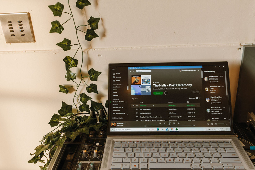 A laptop playing Michelle and Jonathan's wedding playlist