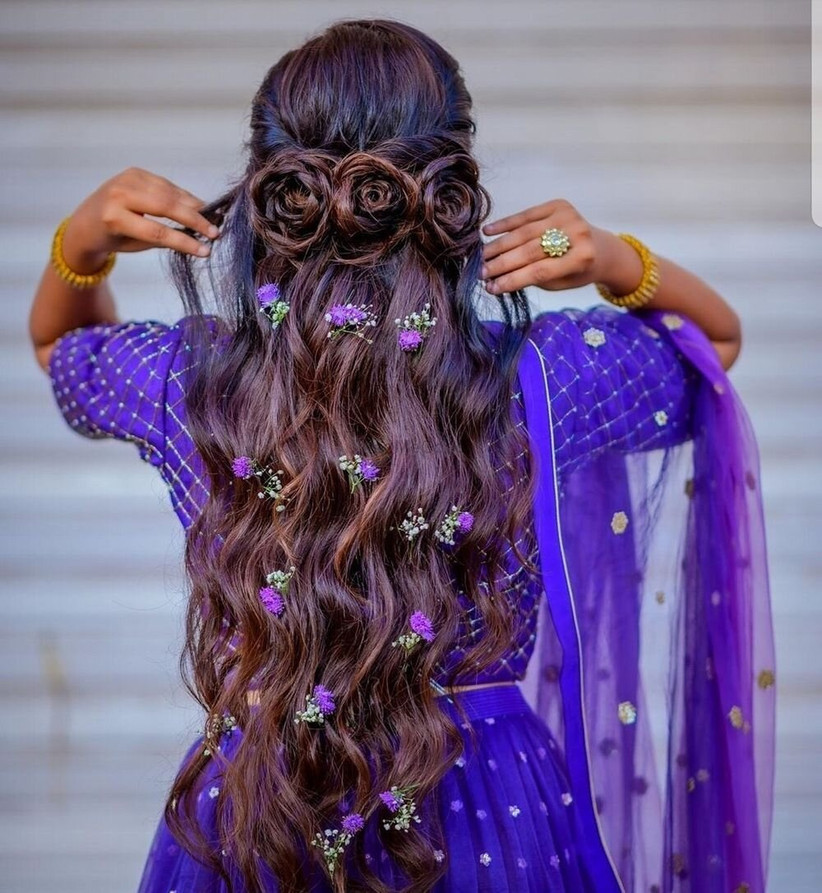 Triple rose half up half down hairstyle with purple flowers