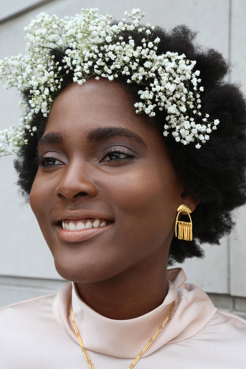 Girl with white flowers in her hair and grey eyeshadow