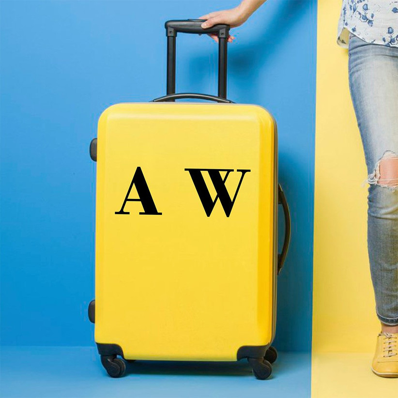 Initialled couple suitcase