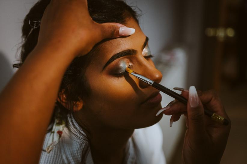 Nirosha having her makeup done