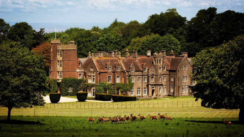 Outside view of a castle overlooking a deer park
