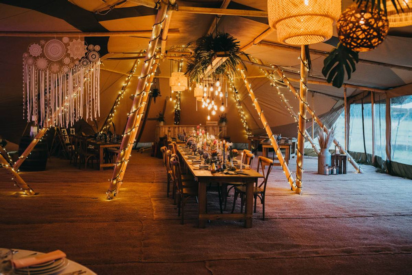 Wedding tipi dining table with fairy lights