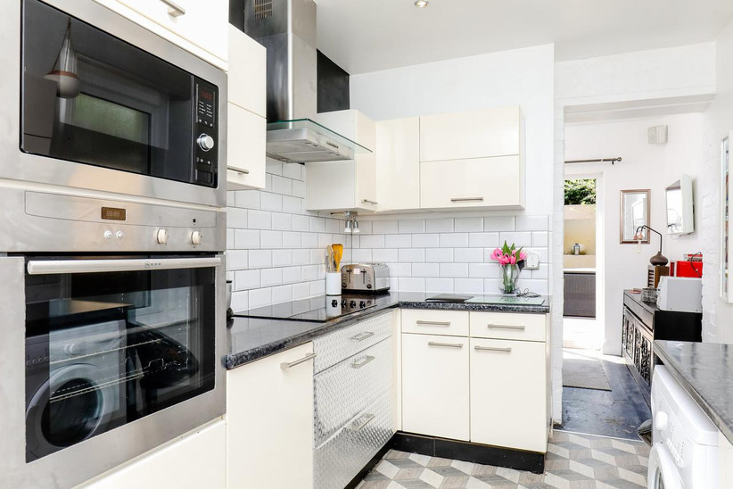 Sleek white kitchen with chrome details