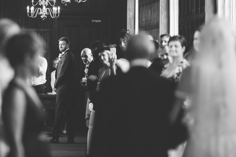 groom-looking-over-his-shoulder-at-the-bride-2