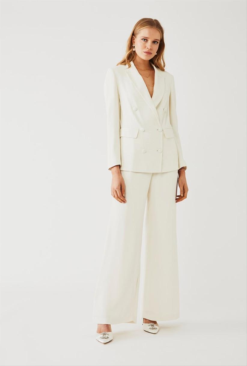 Girl wearing a sleek white suit