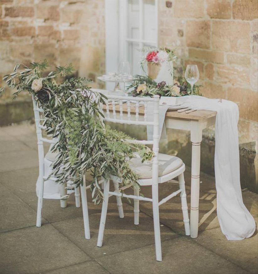 wedding-chairs-decorated-with-fresh-flowers
