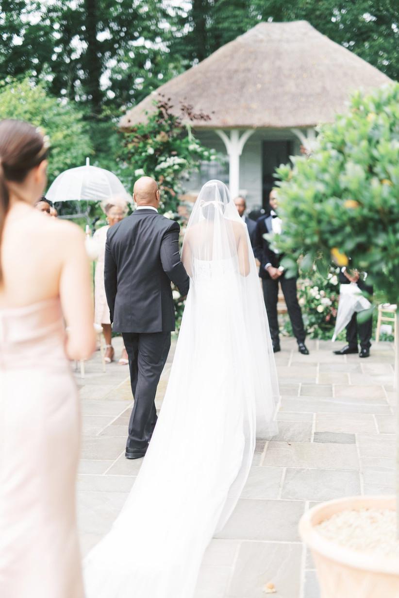 Bride walking down the aisle towards the groom