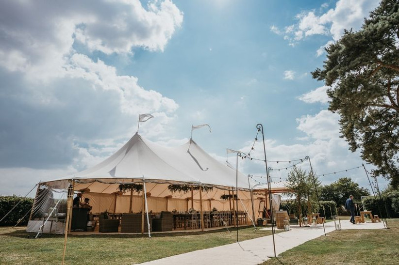 Wedding marquee in a field decorated with flags