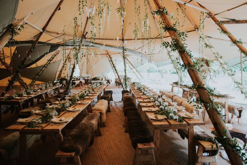 Wedding tipi decorated with green foliage