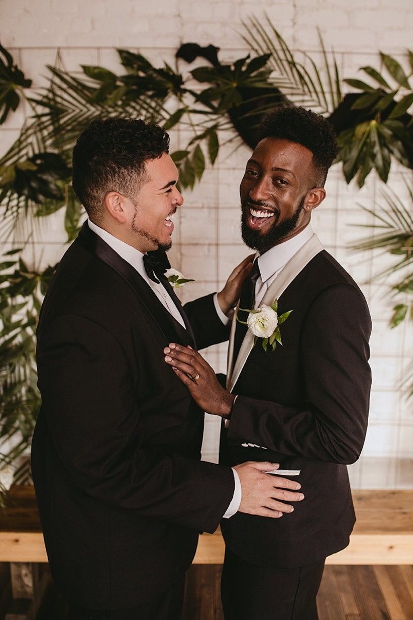Two grooms exchanging vows