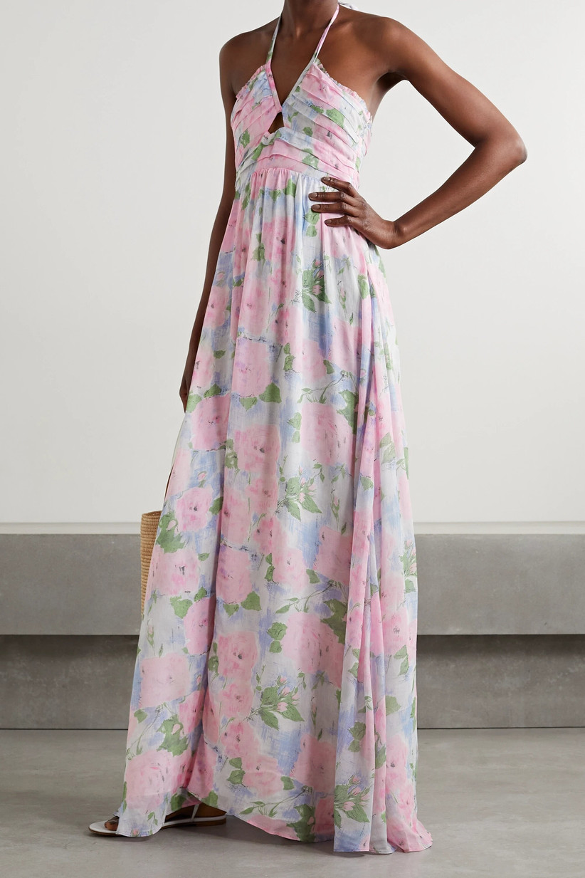 Model wearing a floral halter-neck wedding guest dress