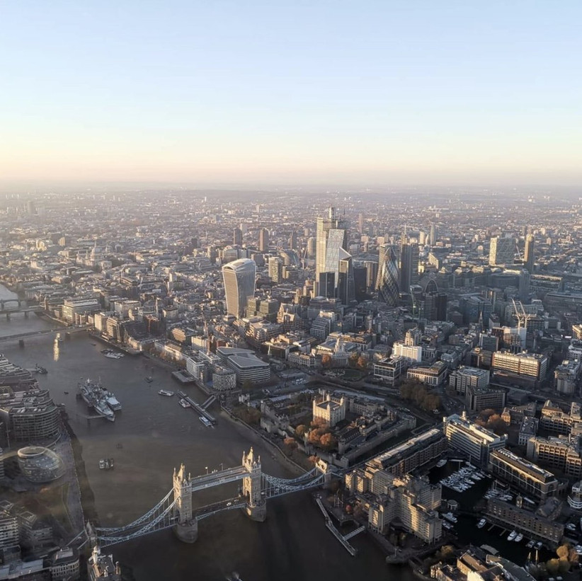 Aerial photo of Tower Bridge and the Thames in London on a sunny evening