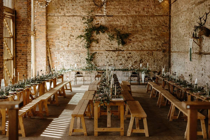 Wedding dining area in a stone barn