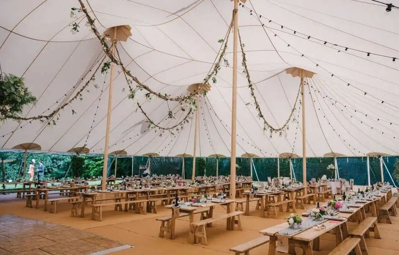 Wedding marquee with wooden benches