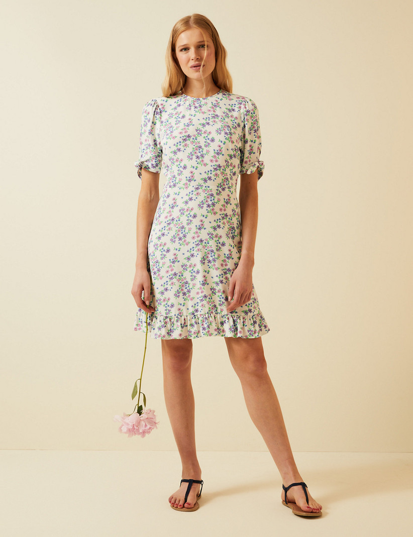Model wearing a short floral dress
